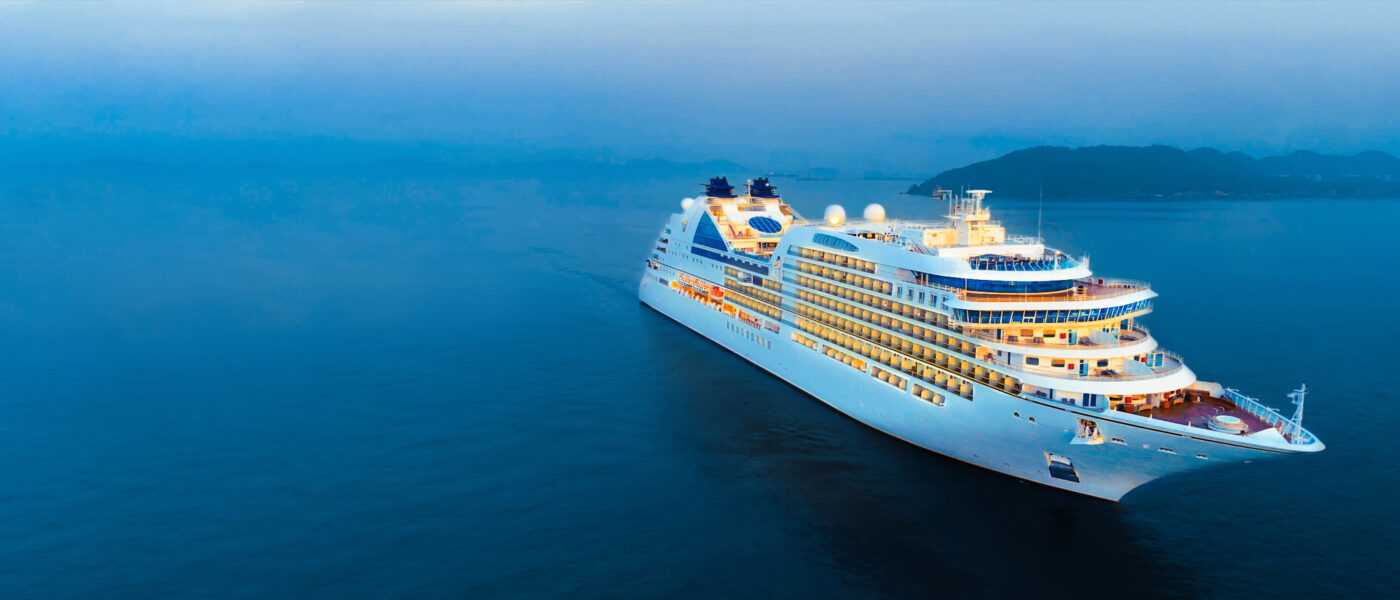 Aerial view of beautiful white cruise ship above luxury cruise in the ocean sea at early in the morning time concept tourism travel on holiday take a vacation time on summer.
